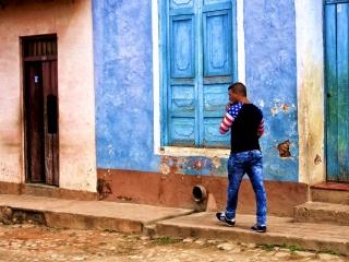 Cuban man wearing an American-flag shirt. Trinidad. Daily life in Cuba