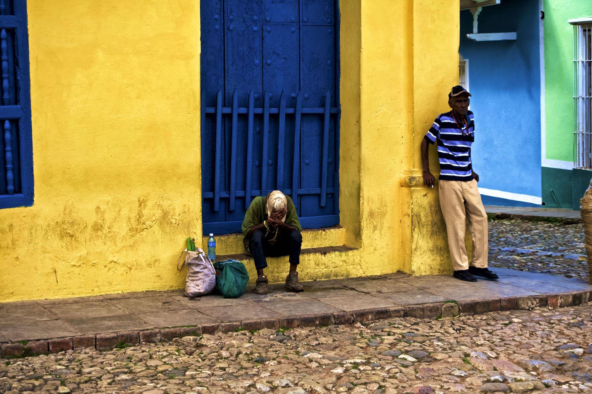 Cuban men in Trinidad. Daily life in Cuba.