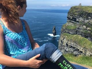 Devon admiring the Cliffs of Moher.