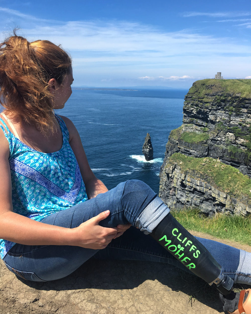 Devon admiring the Cliffs of Moher.