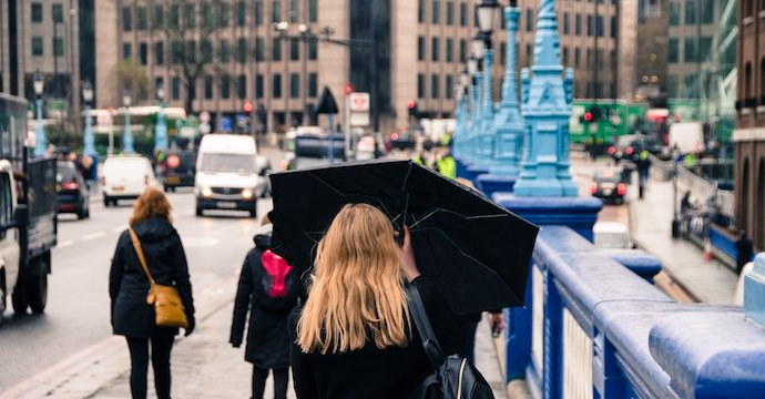 Overcome Travel Obstacles - Raining in London - Authentic Traveling